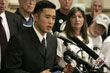 Watada, center, speaks to reporters and supporters, Wednesday, June 7, 2006, in Tacoma, Wash.